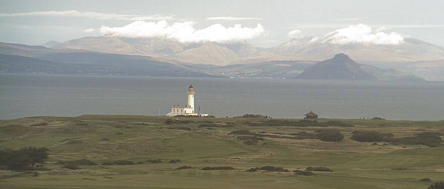 The Turnberry Lighthouse on a clear day unveiling the Isle of Arran on the horizon
